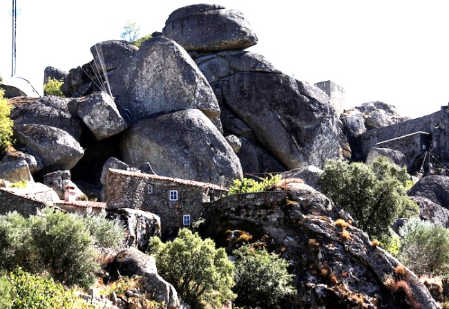 Gently enveloped boulders city Monsanto 2